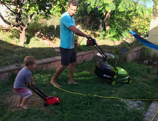 Cam and Daddy Mowing the Backyard
